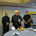 Father Russell with the diocesan curia at his farewell party.